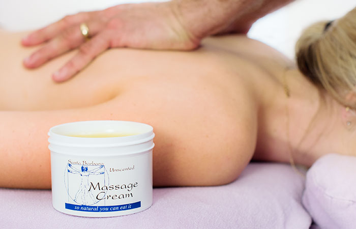 Performing a long stroke with massage cream in the foreground