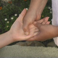 reflexology massage to the hand