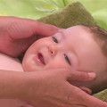 Face massage on an infant