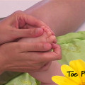 Infant massage toe pulls